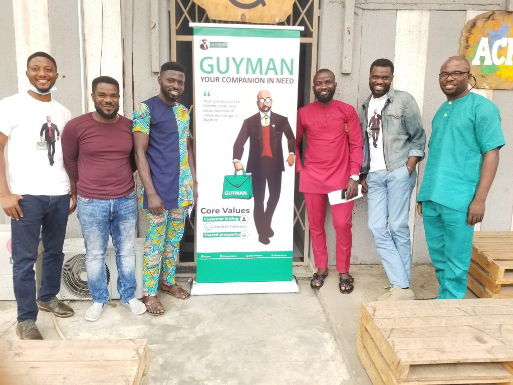 Gozie pose with other benefactors at Guyman seminar on getting BDEs